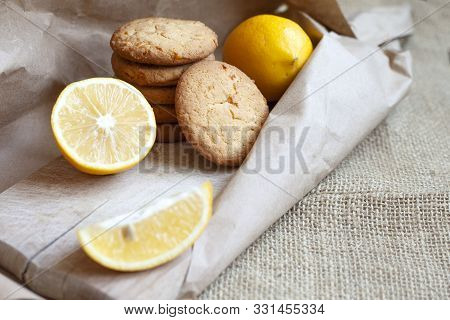 Lemon Cookies Made At Home, Citrus Baking Deliciously Lies On A Table In A Paper Wrapper, A Recipe F