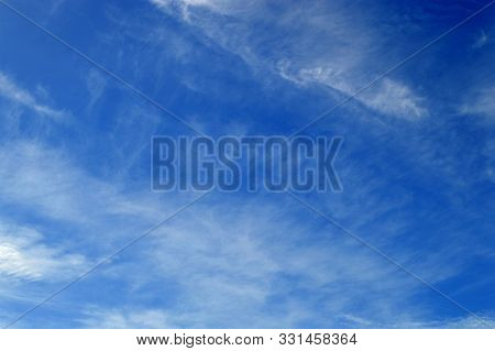 Streaky Cloud Formation Are Contrasted By A Blue Sky In Portugal