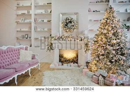 Living Room In Pastel Colors With A Christmas Decor. Christmas Living Room With Sofa, Christmas Tree