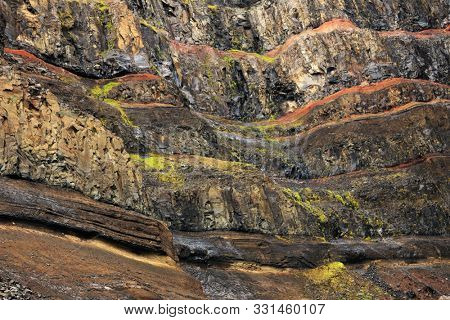Geological layers of earth - layered rock. Close-up of sedimentary rock in Iceland, Europe