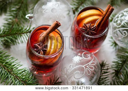 Mulled Wine In Glass Mug Mulled Wine In Glass Mug With A Lemon, Cinnamon Sticks And Star Anise On Wh