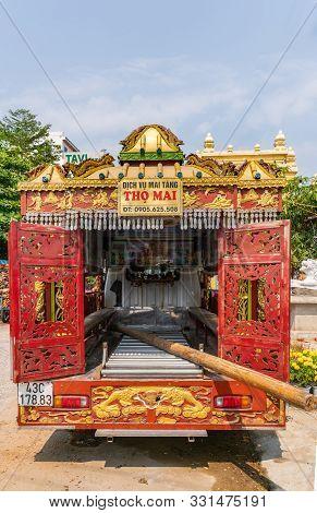Da Nang, Vietnam - March 10, 2019: Look In Bakc Of Van Rebuilt As Gold-red Hearse With Elaborate Dec