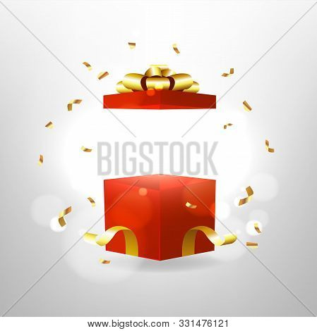 Opened Red Gift Box With Red Bow And Gold Ribbon. Surprise Box With Magic Effect.