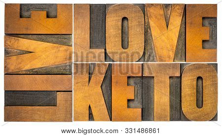 live, love keto, high fat ketogenic diet concept - isolated word abstract in vintage letterpress wood type, healthy lifestyle