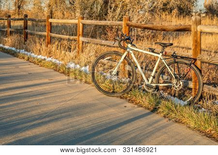touring bike on a bike trail in late fall scenery - Poudre River Trail in northern Colorado