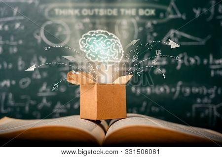 Think Outside The Box On School Green Blackboard . Startup  Education Concept. Creative Idea. Leader