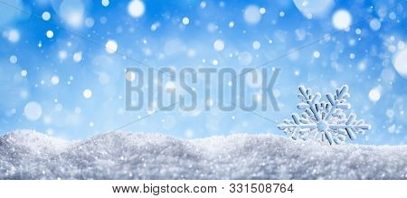 Winter Snow Background With Decorative Snowflake Against Blue Sky. Banner Format. Beautiful Winterti