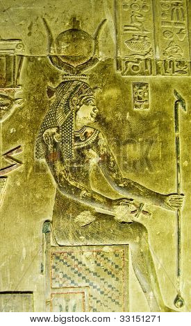 Alabaster bas relief of a woman sitting on an ancient Egyptian throne.  Reputed to be Cleopatra wearing the crown of Hathor.  Crypt of Dendera Temple, near Qena, Egypt. poster