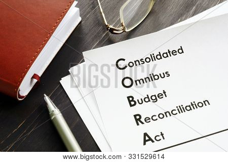 Cobra Consolidated Omnibus Budget Reconciliation Act On The Desk.