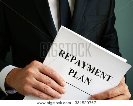 Repayment Plan Papers That The Man Holds.