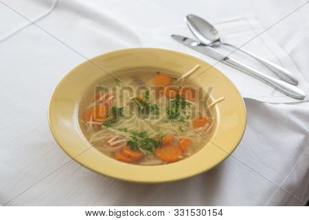 Eating Home Cooked Soup Wit Carrots And Noodels