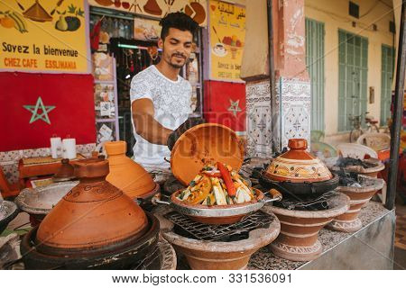 Rissani, Morocco - September 18th, 2019: Young Moroccan Man Cooking Tajine With Vegetables In The St