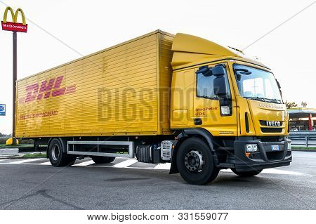 Piedmont, Italy - September 12, 2019: Dhl Delivery Truck Iveco Eurocargo At The Interurban Road.
