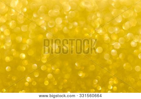Abstract Gold Texture Glitter Lights Background. De-focused.