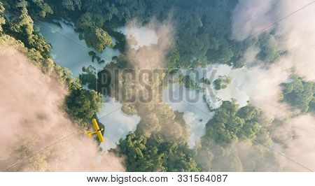 Aerial View Of Misty Rainforest Lakes In Shape Of World Continents In Dense Jungle Vegetation In Bea