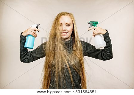 Girl Messy Long Dry Hair Holding Bottle, Applying Thermal Protect Hair Spray.