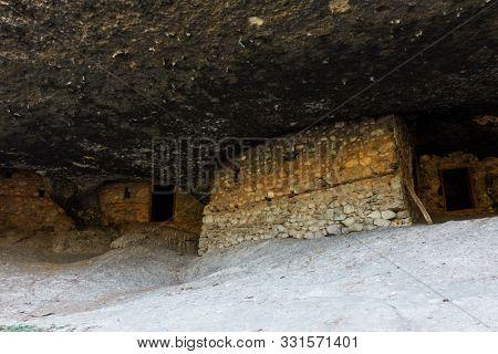 Abode of ancient orthodox hermits in cave near Kastraki village, in Meteora, Greece