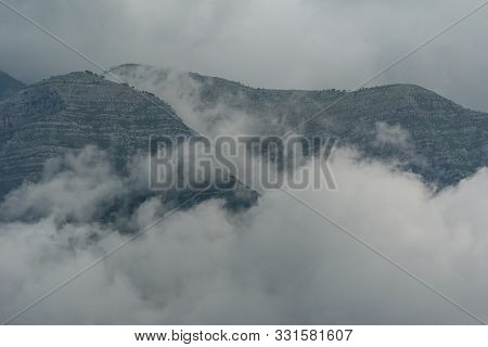Landscape With Mountains And Clouds In Gray Colors