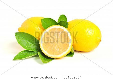 Lemon Isolated On White Background. Lemon Fruit, Vitamin C, Ripe Juicy Lemons, Orange And Green Leav