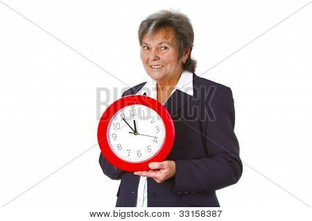 Senior Boss Holding A Round Clock
