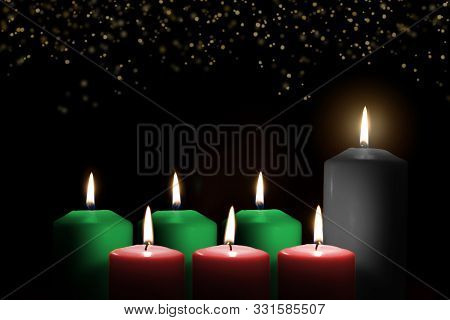 Kwanzaa for African-American cultural holiday celebration with candle light of seven candle sticks in black, green, red symbolising 7 principles of African Heritage (Nguzo Saba) poster