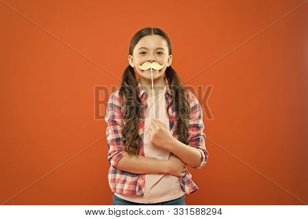 Mustache Mania. Little Child With Fake Mustache On Orange Background. Cute Small Girl Holding Mustac
