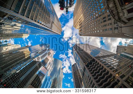 Uprisen Angle With Fisheye Scene Of Downtown Chicago Skyscraper With Reflection Of Clouds Among High