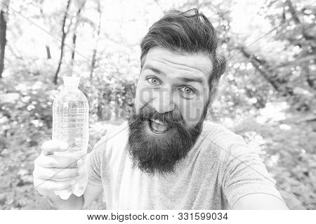 Thirst Is Everything. Thirsty Man. Bearded Man Holding Bottle Of Drinking Water To Quench His Thirst
