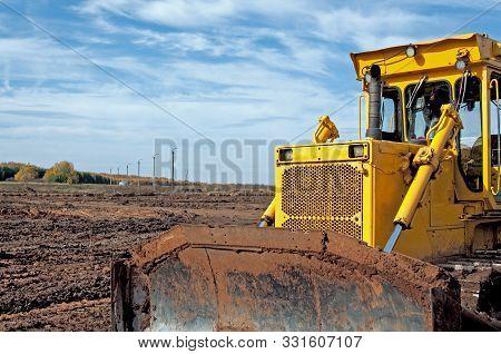 Large Construction Bulldozer At A Construction Site. Ground Planning At A Construction Site. Excavat