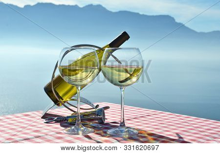 White wine against Geneva lake. Lavaux region, Switzerland