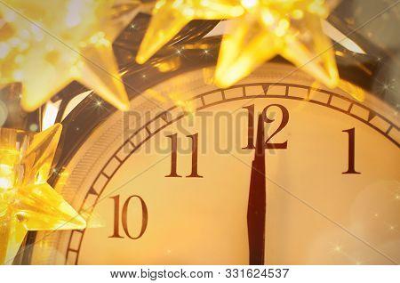 New Year Alarm Clock Wrapped Into Festive Star Garland. Midnight.