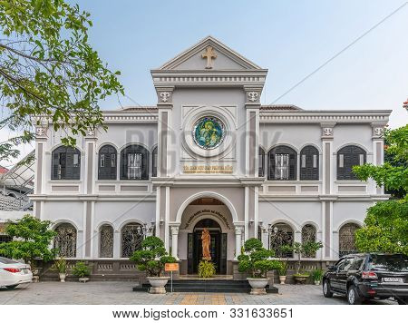 Da Nang, Vietnam - March 10, 2019: Gray House Of The Catholic Bishop Of The Local Diocese Under Blue