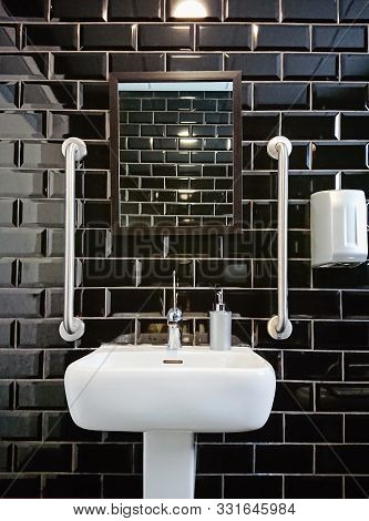 Modern Design Of Toilet Closet Room With Black Glossy Tiles. Gloss Black Tile For Contemporary Decor
