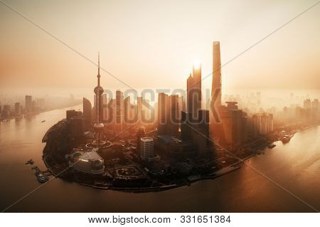 Shanghai city sunrise aerial view with Pudong business district and skyline in China.