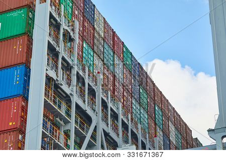 ROTTERDAM, THE NETHERLANDS - SEPTEMBER 15, 2017: Containers stacked on a container ship at APM terminals. The port of Rotterdam is the busiest cargo port in Europe
