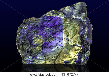 Beautiful Shiny Labradorite Gemstone On Dark Background