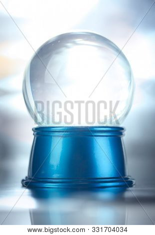 Blank empty snowglobe. Glass snow globe on blue base.