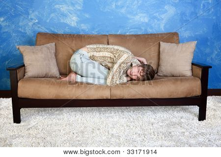 Teen On Sofa In Fetal Position