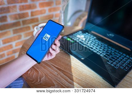 Chiang Mai, Thailand - Oct.18,2019: Woman Holding Xiaomi Mi Mix 3 Mobile Phone With Linkedin Applica