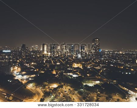 Illuminated Night City, Tel Aviv, Israel. Residential Districts And Business Centre Of The Metropoli