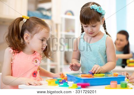 Preschool Children Learning Shapes. Early Education And Daycare Concept