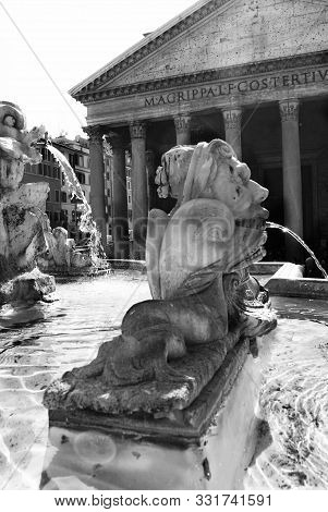 Detail In Black And White Of The  Fountain In Front At Pantheon In Rome
