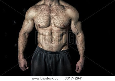 Perfect Look. Torso With Six Packs Looks Attractive On Black Background. Muscular Torso With Huge Mu