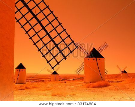 Sunset with windmills in Campos de Criptana (Spain)
