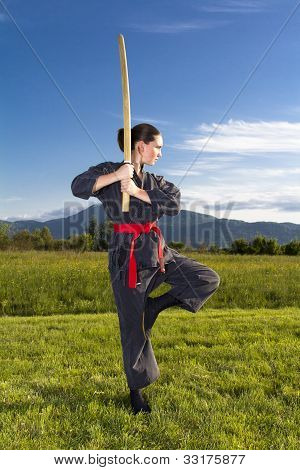 Woman ninja with katana sword