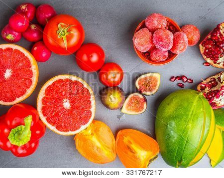 Fresh Red, Orange, Yellow Fruit And Vegetables Rich In Antioxidants, Fiber, Alfa Carotene, Lycopene,