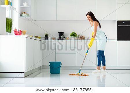 Profile Side Full Size Photo Of Positive Cheerful Girl Having Mop Washing Floor Wearing White Single