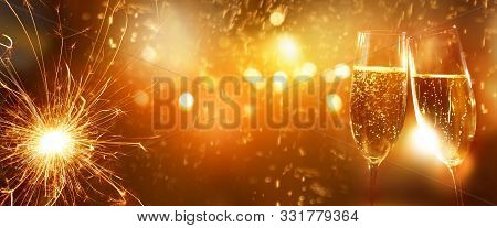 New Years Eve Champagne With Fireworks In The Background For New Year Greetings