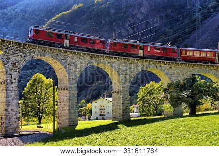 Swiss Mountain Train Bernina Express Passes The Spiral Of The Brusio Viaduct