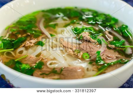 Beef Soup Pho Bo Soup, Vietnamese Cuisine, First Course With Noodles And Vegetables. Vietnamese Pho